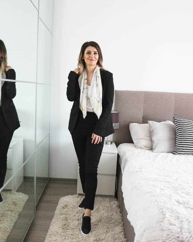all black outfit with blazer and trainers