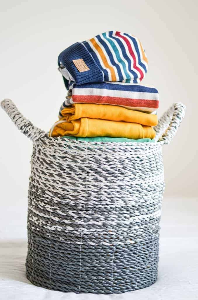 basket with colourful toddler clothes