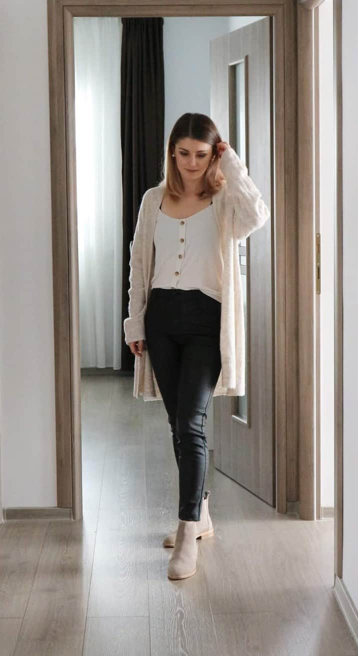 camel cardigan with statement buttons top and black coated jeans outfit