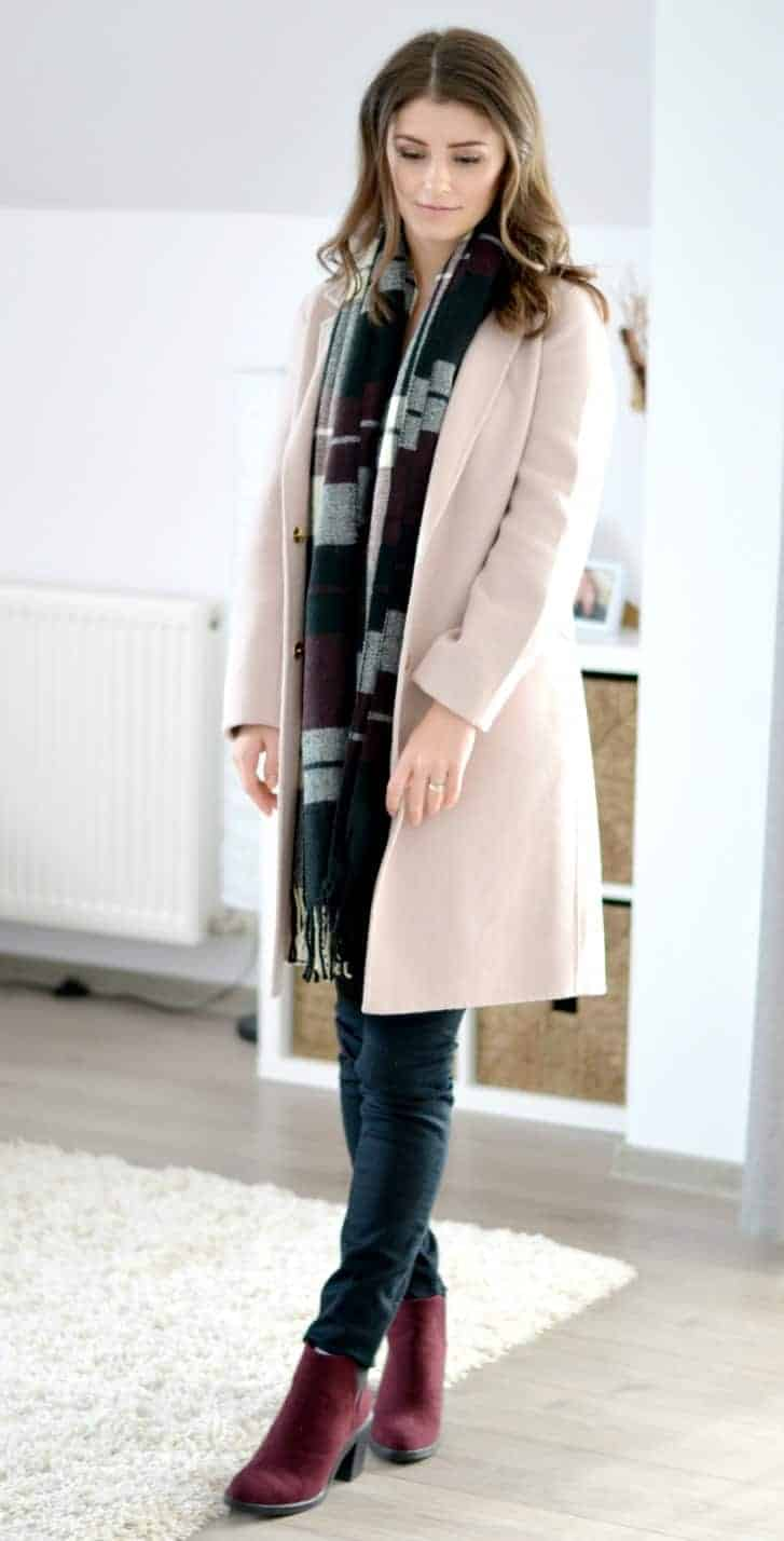 dusty pink coat with burgundy blanket scarf and ankle boots for fall and winter