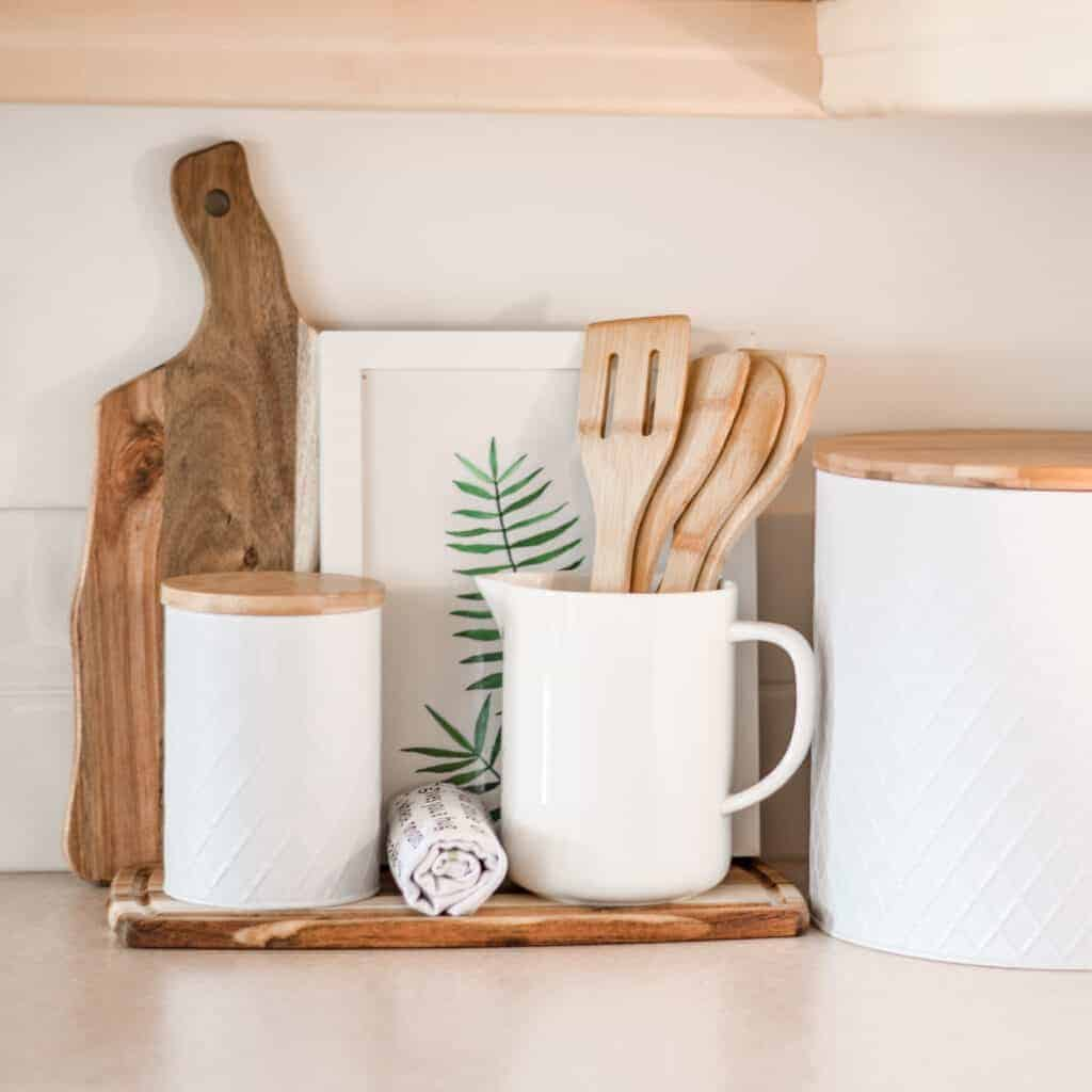 kitchen worktop decor with spatulas, cutting boards and canisters