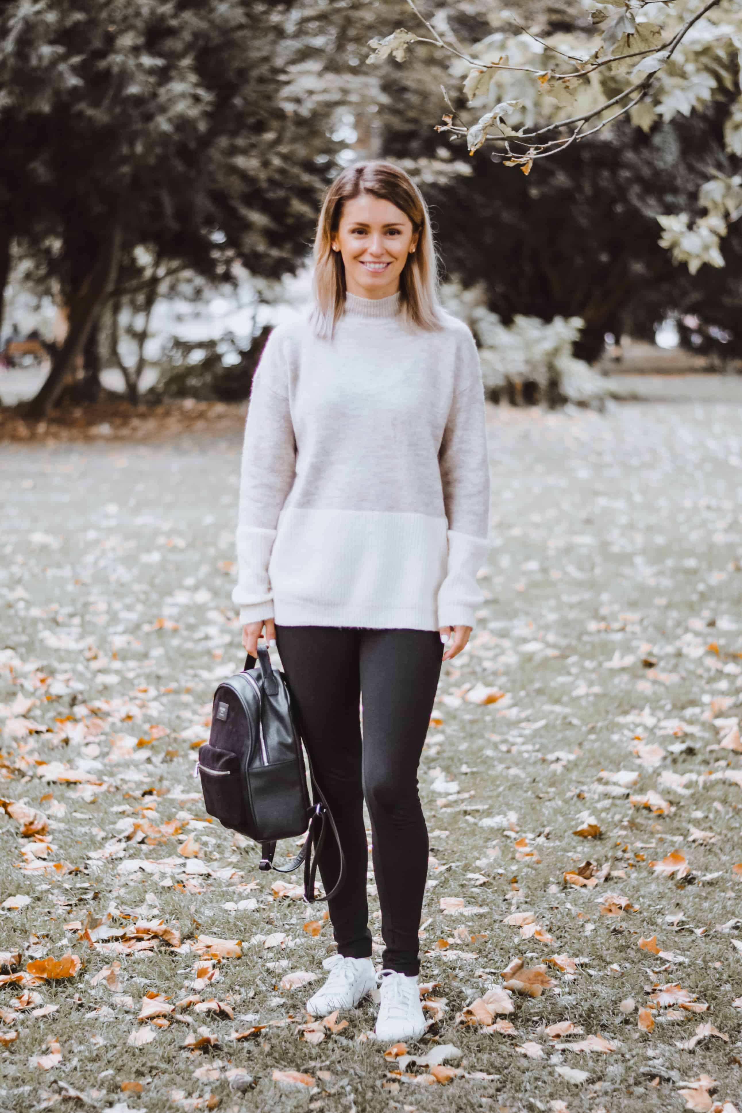 grey and cream sweater with leggings and black backpack style