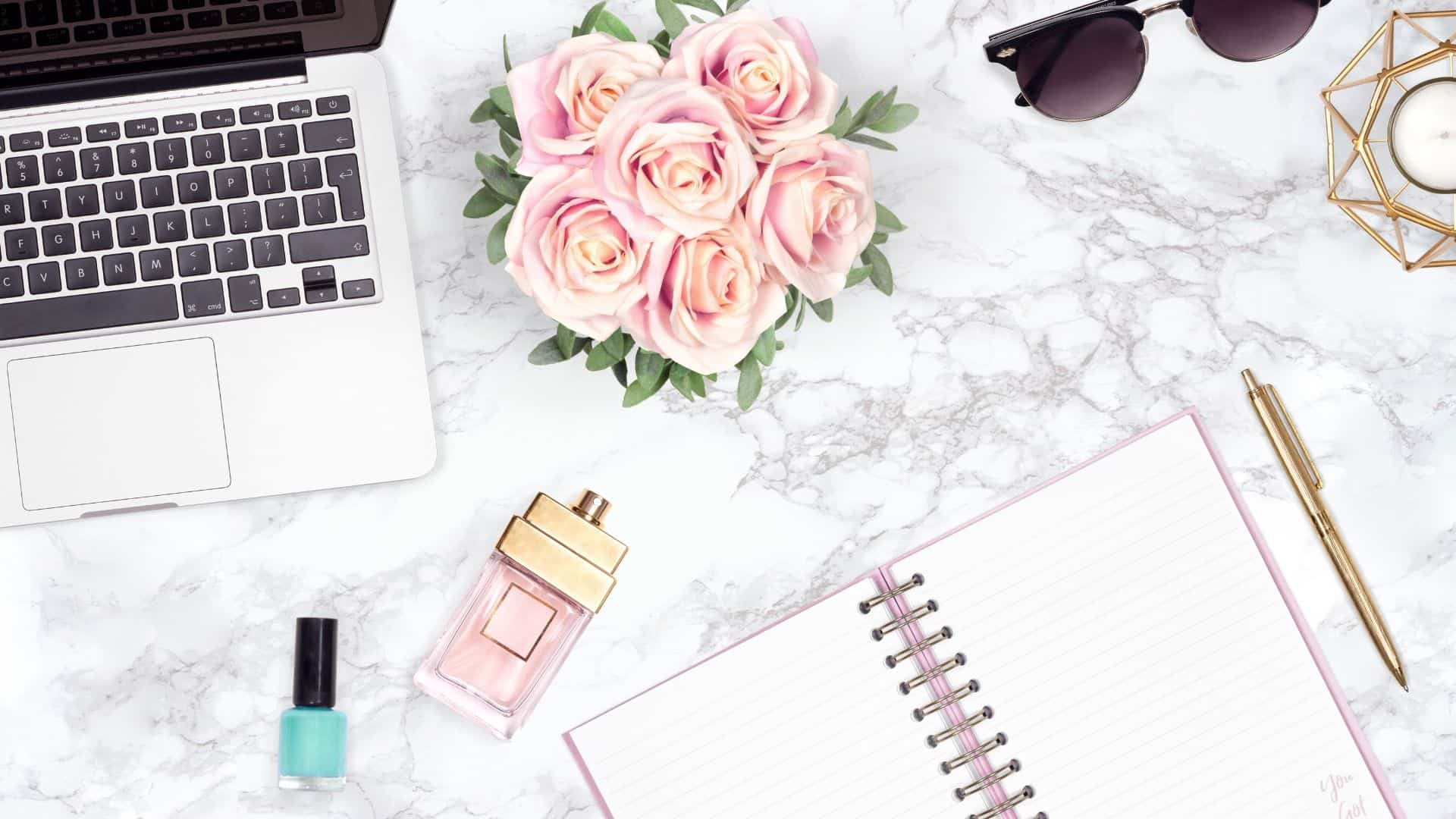 pink girly flatlay example with roses and marble background