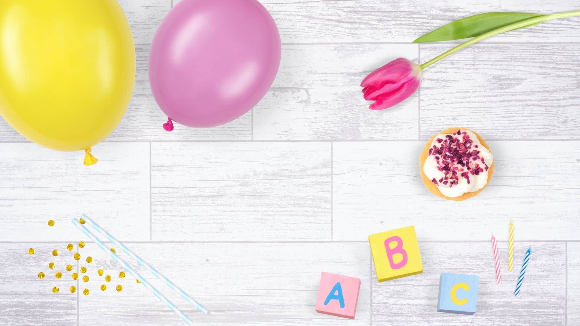 pink baby flatlay example with wooden board and kids props