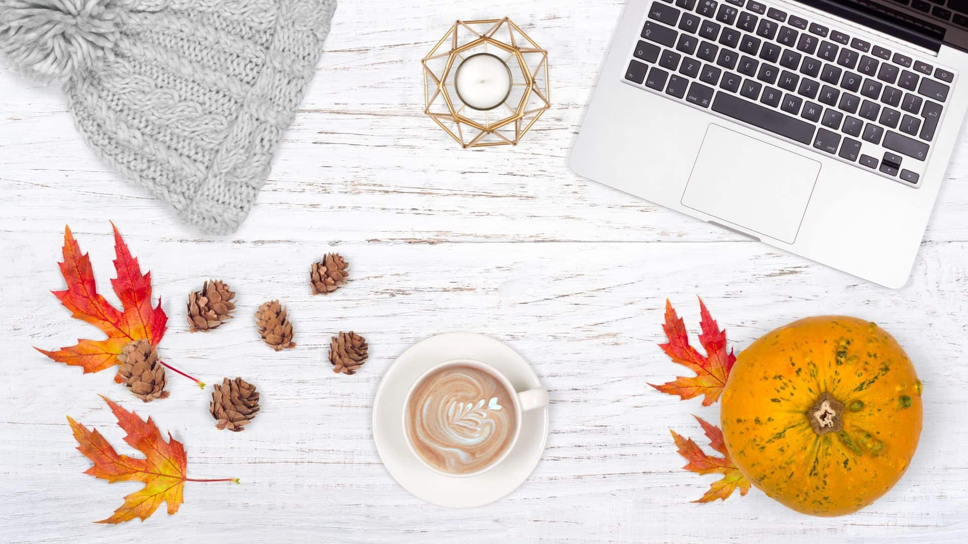 autumnal flatlay example with wooden background, pumpkins and leaves