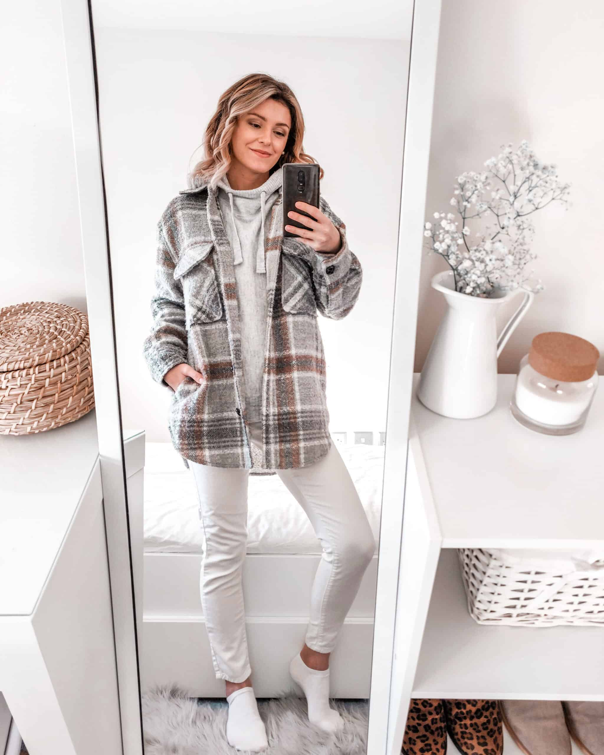 primark check jacket outfit with grey hoodie and white jeans