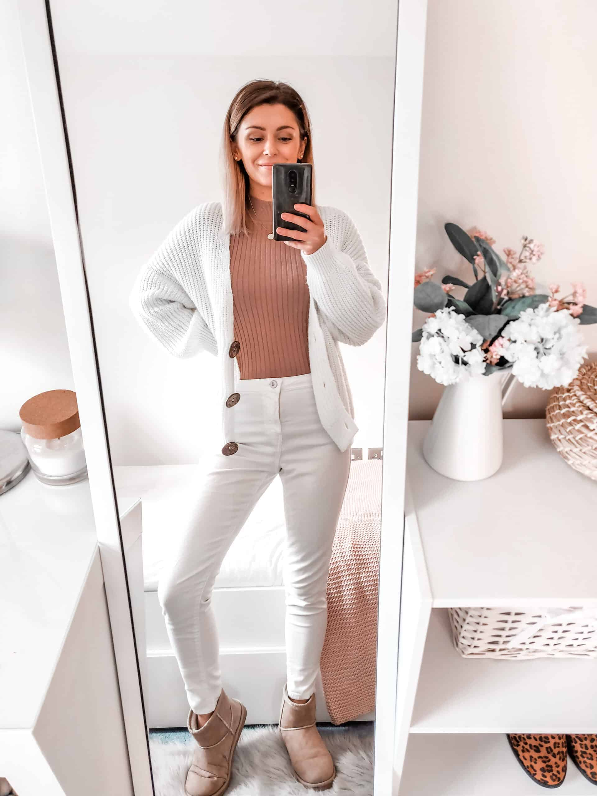 white jeans white cardigan and camel jumper outfit