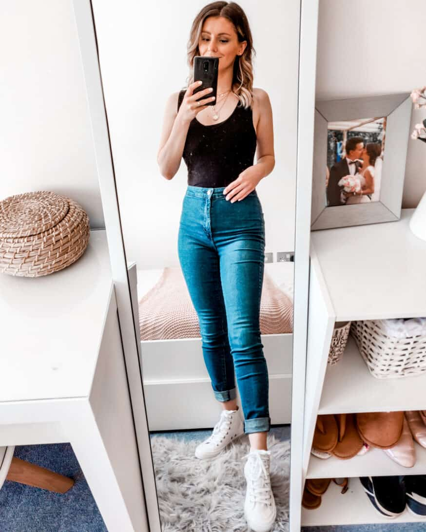 black bodysuit high waisted jeans outfit