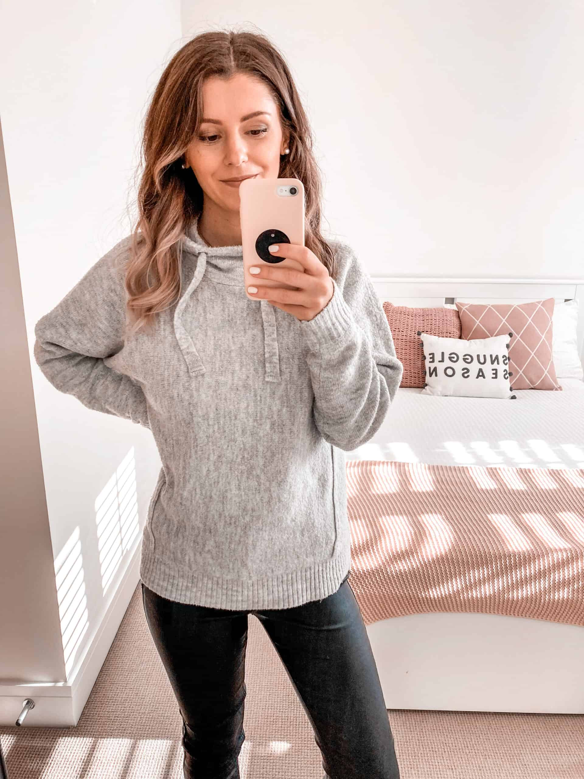 Grey knit hoodie coated jeans black trainers autumn outfit